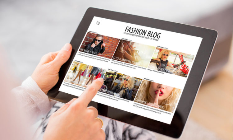 Woman reading fashion blog on iPad tablet